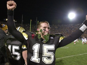 Purdue's Drew Brees, clenches a rose in his teeth as he celebrates Purdue's 43-14 victory over Indiana on Saturday, Nov. 18, 2000, in West Lafayette, Ind. The win earned Purdue an invitation to the Rose Bowl. (AP Photo/David Umberger) ORG XMIT: INDU105
