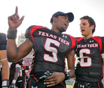 Texas Tech wide receiver Michael Crabtree (5) and quarterback Graham Harrel celebrate the 35-7 win over Texas A&M in a college football game in Lubbock, Texas, Saturday, Oct. 13, 2007. (AP Photo/LM Otero)