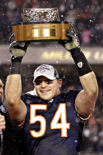brian-urlacher-with-halas-trophy
