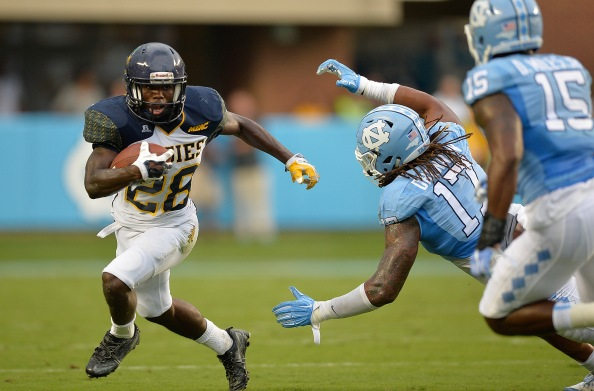 CHAPEL HILL, NC - SEPTEMBER 12: Tarik Cohen #28 of the North Carolina A&T Aggies runs against Dajaun Drennon #17 of the North Carolina Tar Heels during a game at Kenan Stadium on September 12, 2015 in Chapel Hill, North Carolina. (Photo by Grant Halverson/Getty Images)