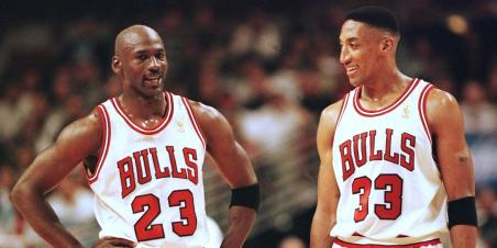 CHICAGO, UNITED STATES: Michael Jordan (L) and Scottie Pippen (R) of the Chicago Bulls talk during the final minutes of their game 22 May in the NBA Eastern Conference finals aainst the Miami Heat at the United Center in Chicago, Illinois. The Bulls won the game 75-68 to lead the series 2-0. AFP PHOTO/VINCENT LAFORET (Photo credit should read VINCENT LAFORET/AFP/Getty Images)