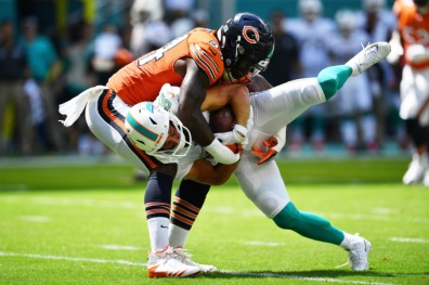 MIAMI, FL - OCTOBER 14: Danny Amendola #80 of the Miami Dolphins is picked up by Leonard Floyd #94 of the Chicago Bears in the first quarter of the game at Hard Rock Stadium on October 14, 2018 in Miami, Florida. (Photo by Mark Brown/Getty Images)