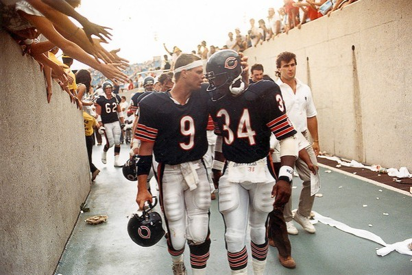 Jim McMahon and Walter Payton walking in tunnel